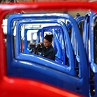 China's factory-gate deflation eases on recovering economy