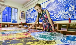 Teacher's paper-cuts feature 56 Chinese ethnic groups