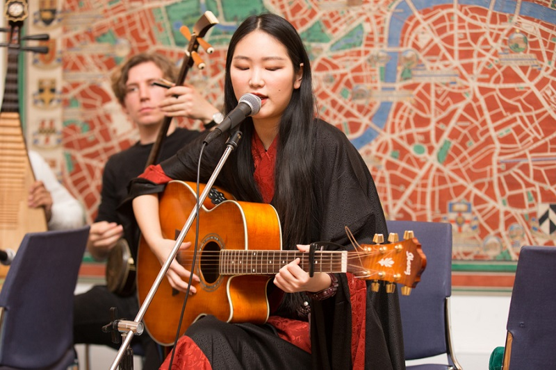 Yijia Tu is performing Mongolian throat singing on AXA Chair Launch event at SOAS, University of London, 6th February 2018. Photograph: Yijia Tu.